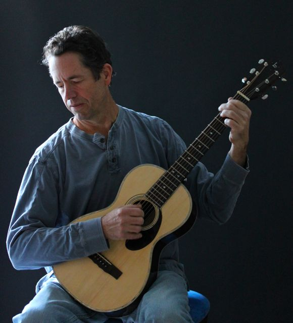NC luthier and musician Jay Lichty playing a Lichty Parlor Guitar