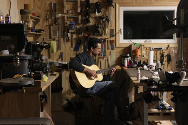 Jay Lichty playing an Ancient Kauri OM Lichty Guitar