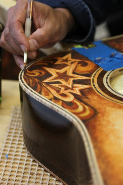 Clark Hipolito (art-company.com) custom design on a custom Lichty Guitar for Mike Gossin