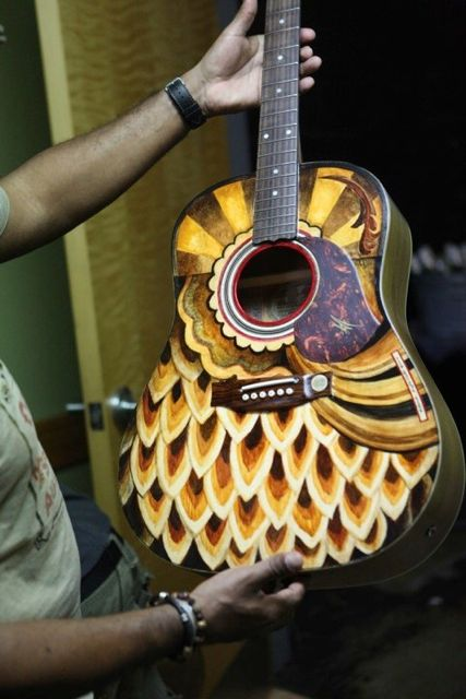 Michael Franti's guitar painted by Clark Hipolito