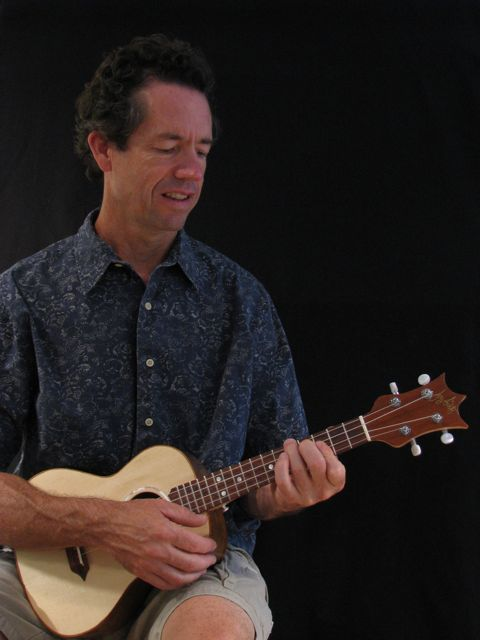 Jay playing a handcrafted Lichty ukulele