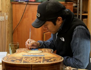 Guitar Artwork being applied by Clark Hipolito