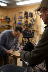 Videographer Erik Olsen filming at Lichty Guitars