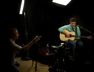 Erik Olsen Shooting video of Noah Guthrie and his Lichty Guitar