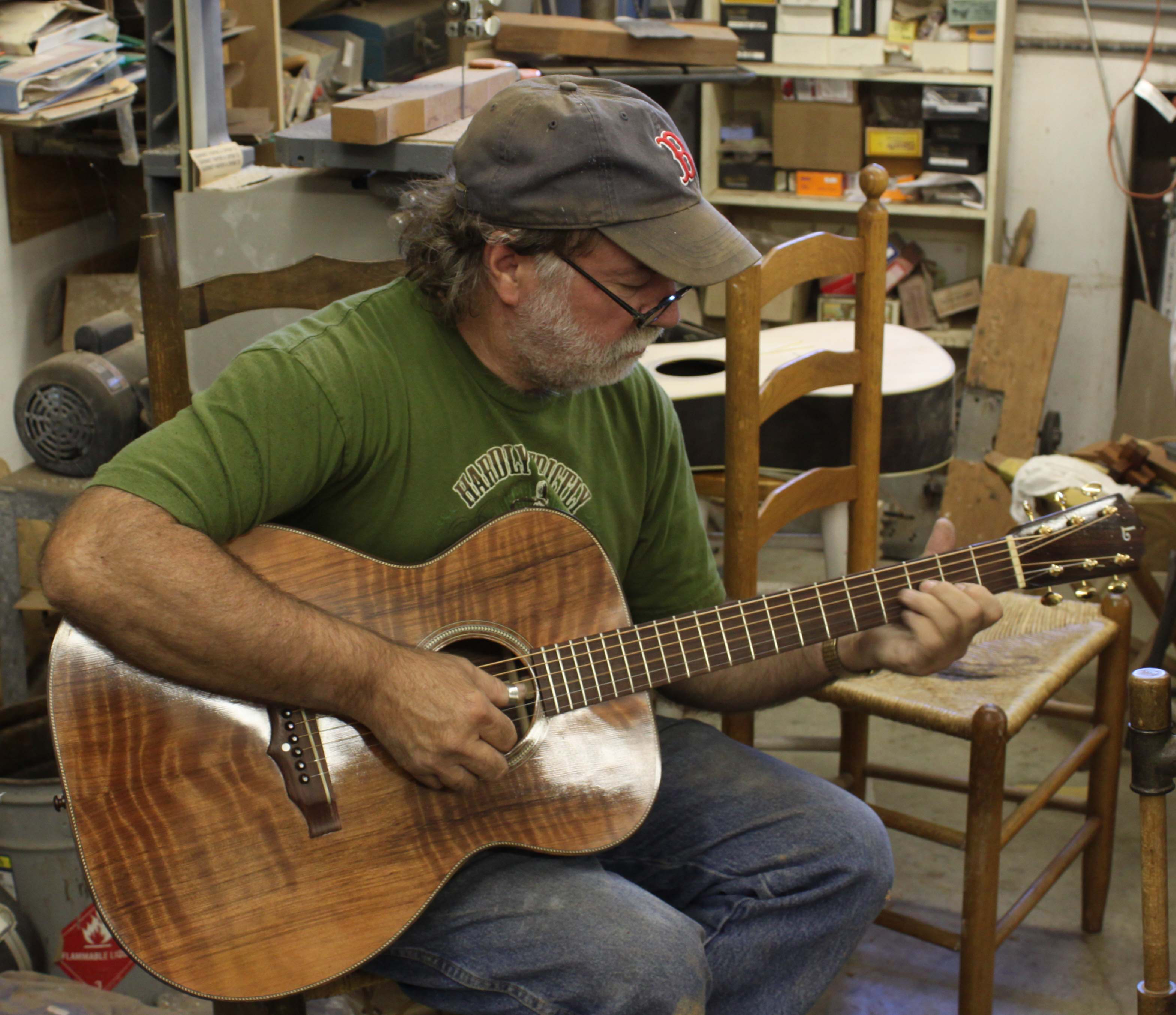 Wayne Henderson playing a Lichty Indian Rosewood OM Guitar with a Curly Redwood top