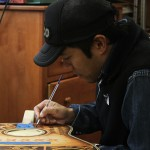 Clark Hipolito hand painting a Lichty Guitar
