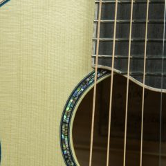 Maple Travel Guitar Gets Strings TG112